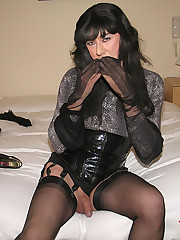 Nylon Bitch Yvette covers her hands in stockings and licks them