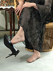 Horny Lucimay masturbates her hard cock into one of her high heels