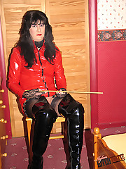 Yvette wearing slutty red PVC and playing with her cock